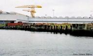 Über die Pfähle links türmte sich während des Baus das Heck der Olympic, über den Pfählen rechts wuchs die Titanic gen Himmel.